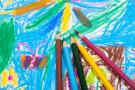 several colored pencils on children draw background photo