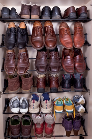 mens shoes: shoes cabinet with used leather male slippers Stock Photo
