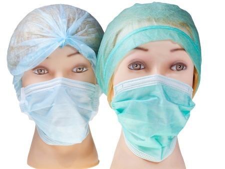 protective mask: female manikin doctor heads wearing textile surgical cap and medical protective mask isolated on white background