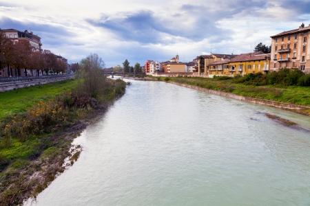 verdi: view of Parma river and Ponte Verdi in autumn day, Italy