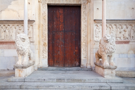 doors of medieval Modena Cathedral, Italy photo