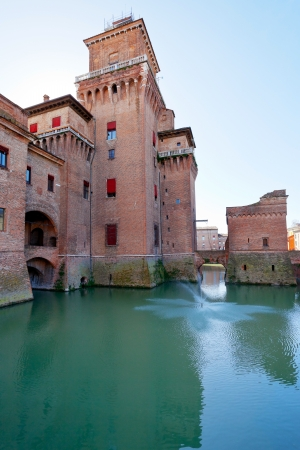 side view moat and Castello Estense in Ferrara, Italy Stock Photo