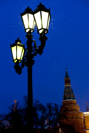 snow in Moscow - urban lantern and Kremlin tower in winter snowing evening photo