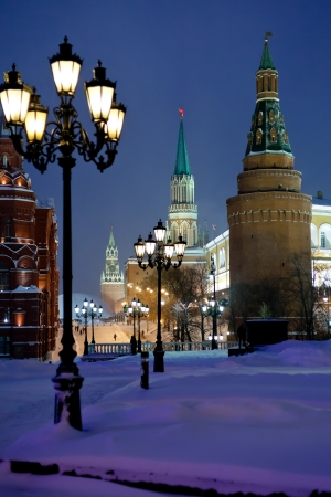 snow in Moscow - Kremlin towers in winter snowing evening photo
