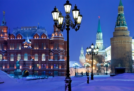 snow in Moscow - Kremlin towers in winter snowing night photo