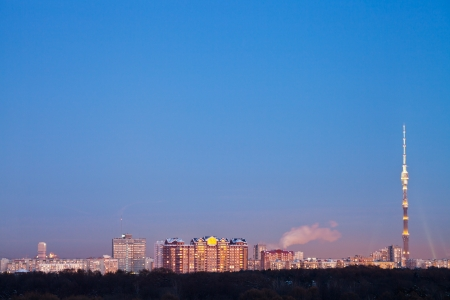 city skyline with TV tower in winter evening photo