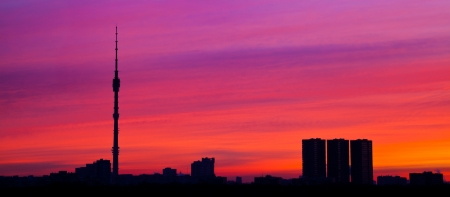 panoramic pink sunrise colors under city with tv tower Stock Photo - 17847521