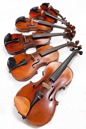 fiddles: different sized fiddles on white background close up Stock Photo