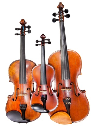 violins: three sizes of violins isolated on white background close up