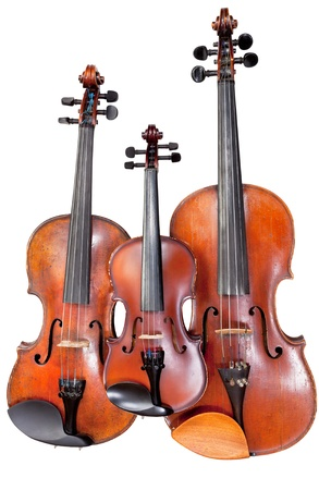 fiddles: three sizes of fiddles isolated on white background close up
