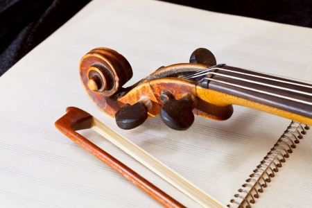 fiddle bow and scroll on music book close up Stock Photo - 17847698