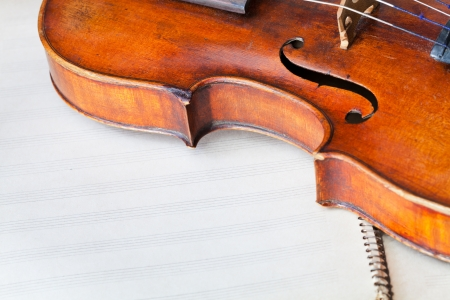violin bout with f-hole on music book close up