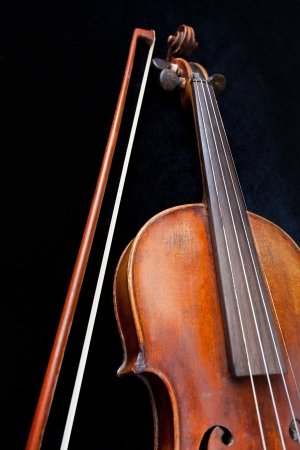 violin and bow on black background close up