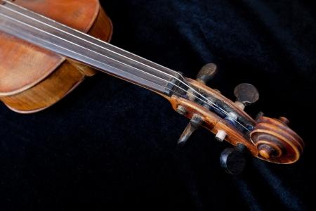 violin scroll on black velvet background close up Stock Photo - 17847655