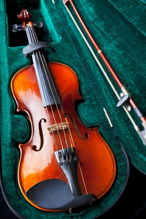 violin with bow in green velvet box close up Stock Photo - 17847760