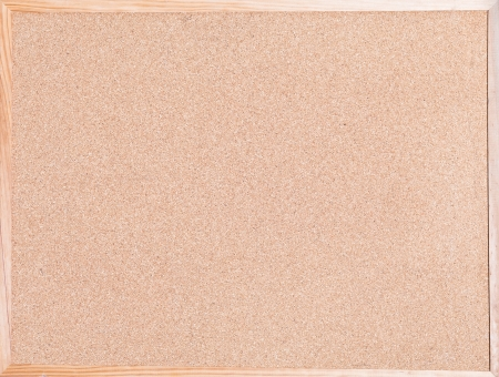 blank cork board in wooden frame photo
