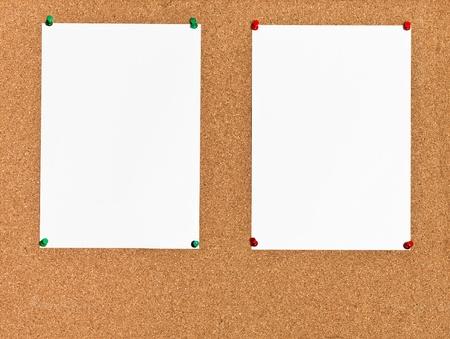 cork board: two white sheets of paper on cork board