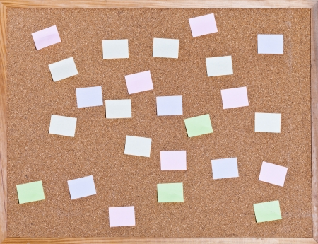 many memo sticks on on cork board in wooden frame photo