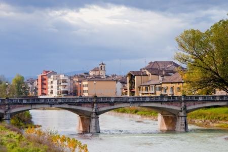 verdi: panorama with Parma stream and Ponte Verdi in autumn day, Italy