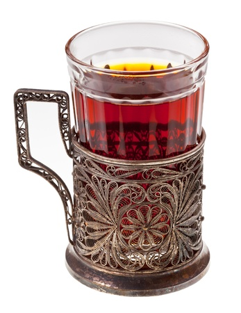 melchior: hot black tea in retro glass with silver glass-holder isolated on white background Stock Photo
