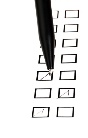 put tick in black square box by black ballpoint pen Stock Photo - 18215110