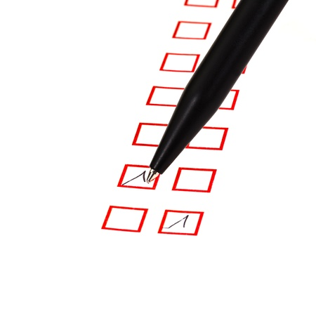 put tick in red square box by black ballpoint pen Stock Photo - 18215119