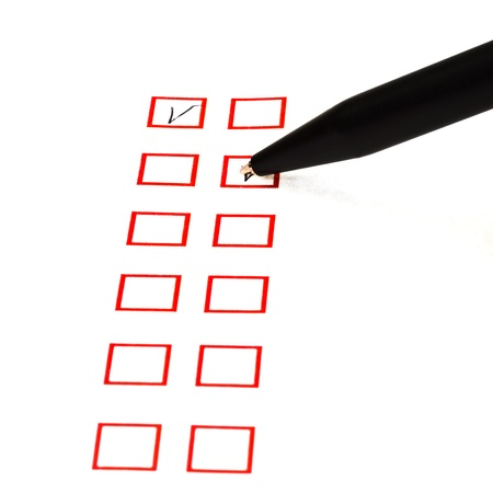put tick in red square box by black ballpoint Stock Photo - 18215114