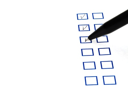put tick in blue square box by black ballpoint pen Stock Photo - 18215121