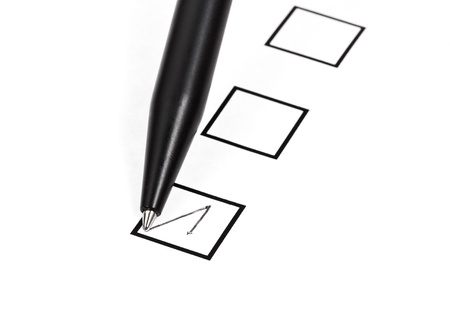 tick in black square box by black ballpoint pen Stock Photo - 18215130