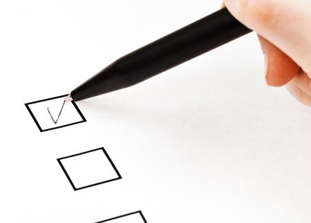 biro: tick in black square box by black pen