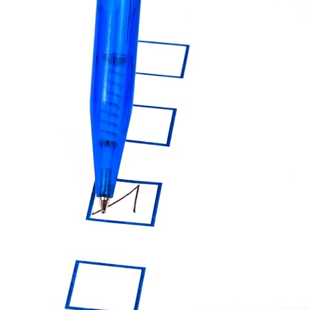 put tick in blue square box by blue ballpoint pen photo