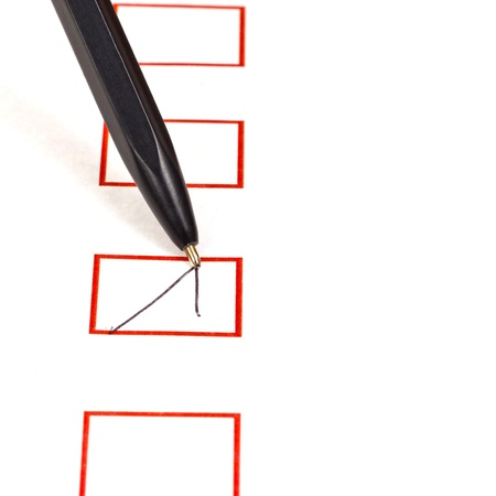 tick in red square box by simple black ballpen photo