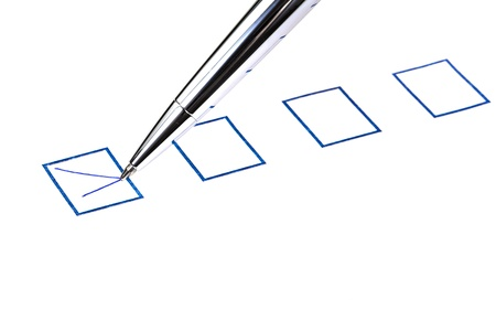 put tick in blue square box by silver pen Stock Photo