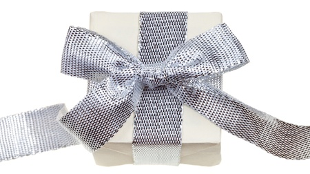 small handmade paper gift box with silver bow isolated on white background Stock Photo - 18215161