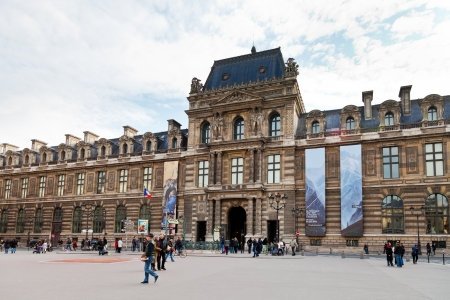housed: PARIS, FRANCE - MARCH 5: Louvre Museum. The museum is housed in the Louvre Palace which began as a fortress built in the late 12th century in Paris, France on March 5, 2013