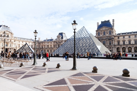 PARIS, FRANCE - MARCH 5: Louvre Palace and Pyramid. The pyramid and its underground lobby were inaugurated on 15 October 1988 in Paris, France on March 5, 2013