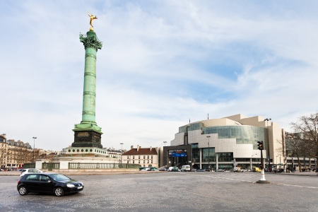 PARIS, FRANCE - MARCH 6: Place de la Bastille and Bastille opera. Bastille Opera House was designed by Uruguayan architect Carlos Ott in Paris, France on March 6, 2013