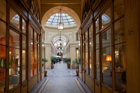 monument historical monument: PARIS, FRANCE - MARCH 7: Galerie Vivienne is a historical monument from 7 July 1974. Passage gallery is 176 metres long and 3 metres wide, in Paris, France on March 7, 2013 Editorial