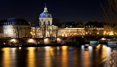 academie: view of French Academy above river in Paris at night