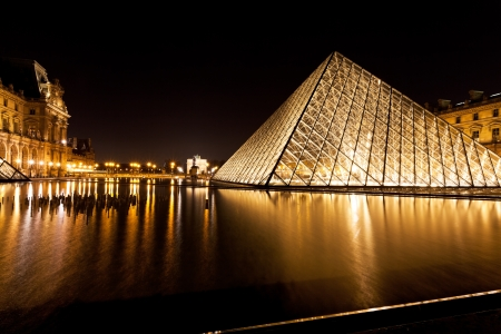 PARIS, FRANCE - MARCH 5: Louvre and Pyramid. in 1983 architect I. M. Pei was awarded the project and proposed a glass pyramid to stand over a new entrance in the main court, in Paris on March 5, 2013