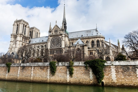 cathedral Notre Dame de Paris and Seine River in cloudy day photo