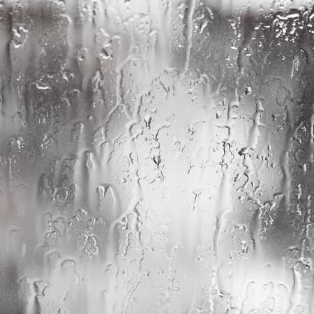 rain window: abstract background rain streams on home glass window