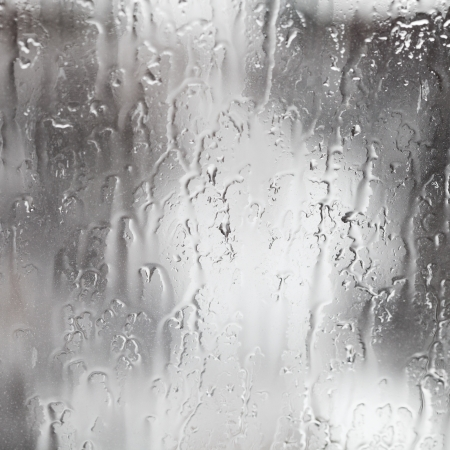abstract background rain streams on home glass window