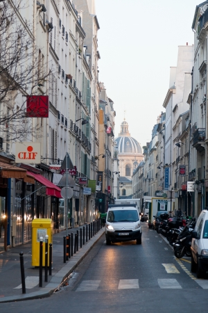 academie: PARIS, FRANCE - MARCH 4: view of dome French Academy through Rue Mazarine. The Institut de France is a French learned society, grouping five academies, in Paris, France on March 4, 2013 Editorial