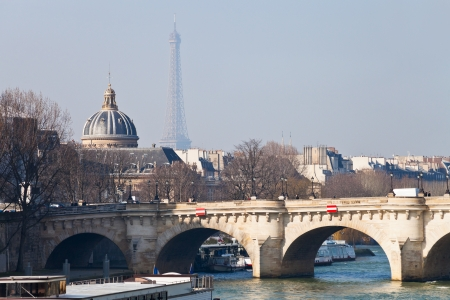 academie: view of Pont Neuf with Eiffel Tower and French Academy on background in Paris Stock Photo