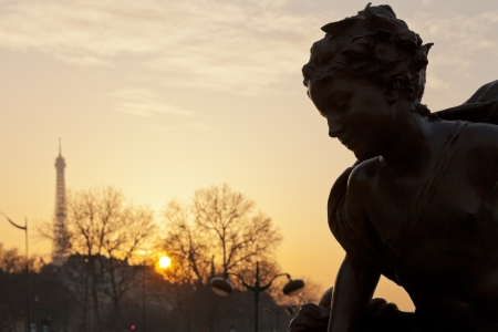alexandre: sculpture of Pont Alexandre III and eiffel tower in Paris at sunset