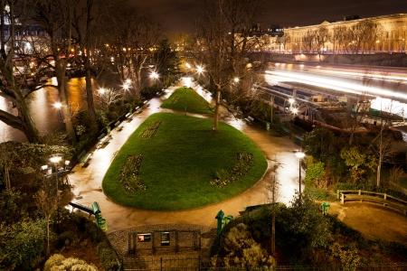 cite: panorama of Square du Vert-Galant on Ile de la Cite in Paris at night