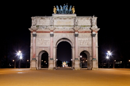 carrousel: The Arc de Triomphe du Carrousel at night in Paris, France