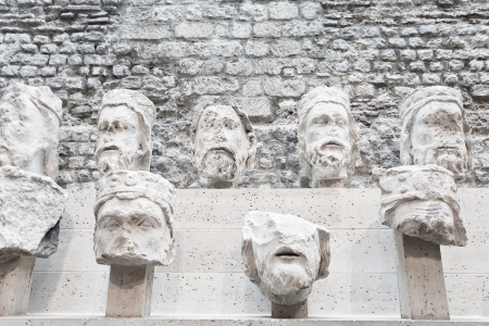 judah: PARIS, FRANCE - MARCH 6: Stone heads of kings of judah from Notre-Dame at the Cluny Museum. 21 heads among the 364 fragments having been recovered in 1977 in Paris on March 6, 2013