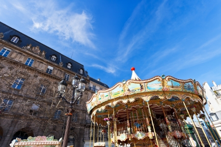 l first: PARIS, FRANCE - MARCH 9: carousel at Place de l Hotel de Ville in Paris, France on March 9, 2013. First French example of carousel was in Paris in 1605.